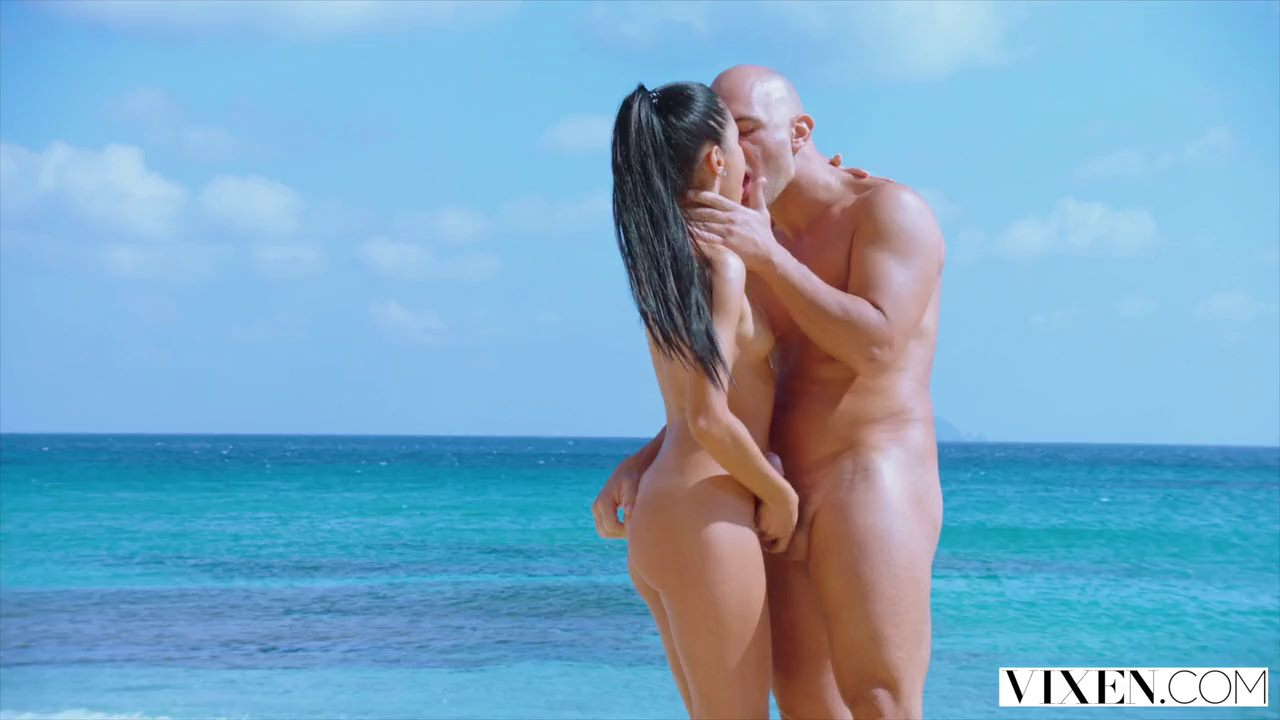 Beautiful brunette, Apolonia Lapiedra is sucking cock on the beach and getting fucked from the back